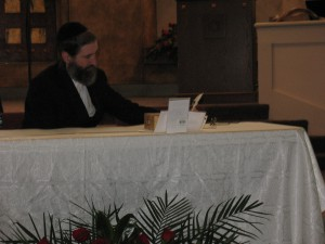 Rabbi Danneman begins to write with his special quill.
